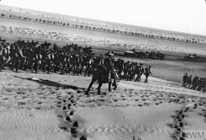 Q57770 Desert Column on way to El Arish. note separation between the camels, mules and men.l