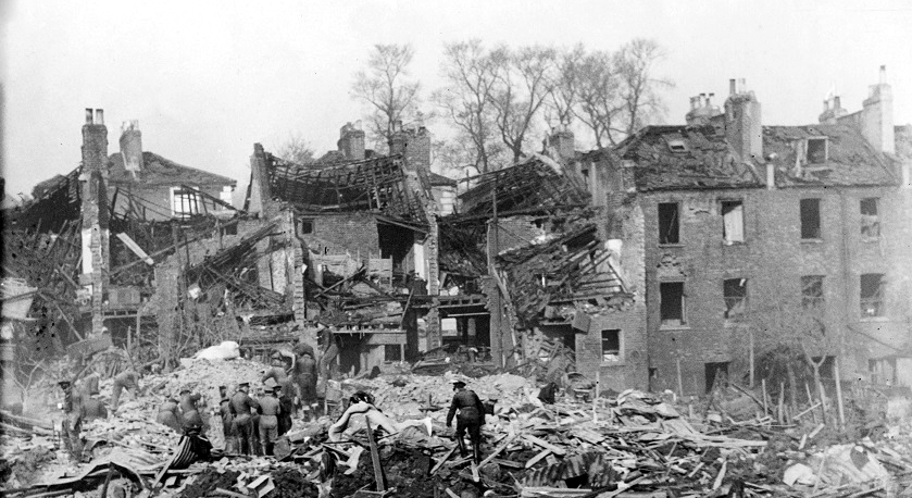 Scene at Holloway after a German V2 rocket fell in the evening destroying 18 houses and causing several deaths during the Second World War. ;Rescue workers search for surviviors amongst the rubble ;November 1944